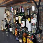 Liquor shelf bracket